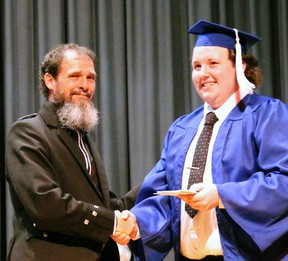Bob Ellison (left) dressed formally in his kilt for special occasions while at Mitchell District High School (MDHS), proud of his Scottish heritage. Here he presents MDHS graduate Jim Tubb with an award at the school's recent Commencement ceremony. SUBMITTED