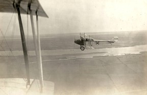 Deseronto Archives Photo Aerial photograph of Curtiss JN-4 aircraft number C126, taken over open fields with some stretches of water from another aircraft, whose wing is visible. The aircraft were from Camp Mohawk, one of the World War I Royal Flying Corps pilot training camps near Deseronto, Ontario.
