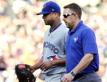 Starting pitcher Francisco Liriano #45 of the Toronto Blue Jays leaves the game against the Detroit Tigers with a trainer during the third inning at Comerica Park on July 15, 2017 in Detroit, Michigan. (Duane Burleson/Getty Images)