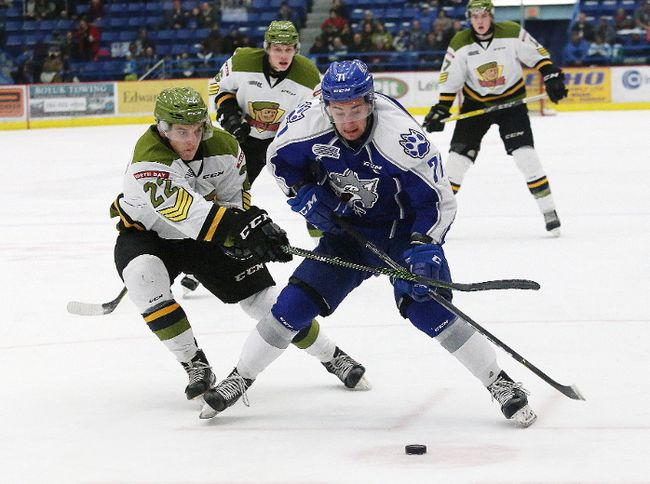 David Levin, right, of the Sudbury Wolves, tries to get around Brady Lyle, of the North Bay Battalion, during OHL action at the Sudbury Community Arena in Sudbury, Ont. on Friday February 17, 2017. John Lappa/Sudbury Star/Postmedia Network