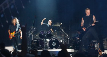 Metallica's James Hammett, Lars Ulrich and James Hetfield  rip it up playing Hardwired as they brought their World Wired tour to the Rogers Centre  in Toronto, Ont. on Sunday July 16, 2017. Jack Boland/Toronto Sun/Postmedia Network