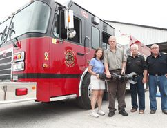 From the left, owners of Progressive Turf Equipment Inc. Bonnie and Luke Janmaat, Huron East Fire District Chief for the Seaforth area, Tom Phillips District and Deputy Chief, Doug Anstett. The Janmaat's recently gave a substantial amount of money; both are holding the Storm Series battery powered extrication tool that was purchased from their donations. (Shaun Gregory/Huron Expositor)