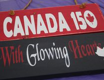 """With Glowing Hearts"" -just some of the words from our National anthem at the sign painintg party sponsored by the Canada 150 committee in Nipawin. 72 peple signed up to paint signs during the Canada 150 celebrations on Main Street on July 16."