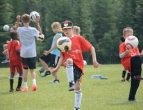 Campers practice kneeing soccer balls during Athletes in Action Soccer Camp at Rotary Park on July 12 (Peter Shokeir   Whitecourt Star).