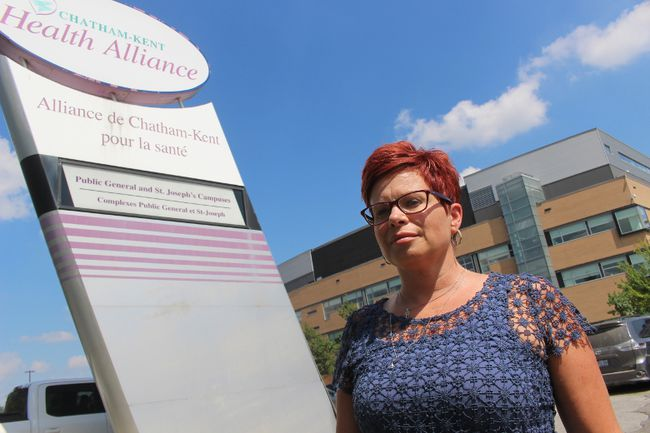 Trish Douma, regional director at the Christian Labour Association Of Canada standing in front of the Chatham-Kent Health Alliance. (Jeremiah Rodriguez/ The Chatham Daily News / Postmedia Network)