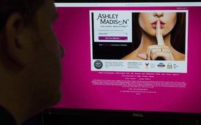 A man looks at the Ashley Madison website in this photo illustration in Toronto on Thursday, August 20, 2015. The Toronto-based parent company of the infidelity dating site Ashley Madison says it has reached a US$11.2-million settlement an American class-action lawsuits stemming from a massive security breach two years ago. THE CANADIAN PRESS/Graeme Roy
