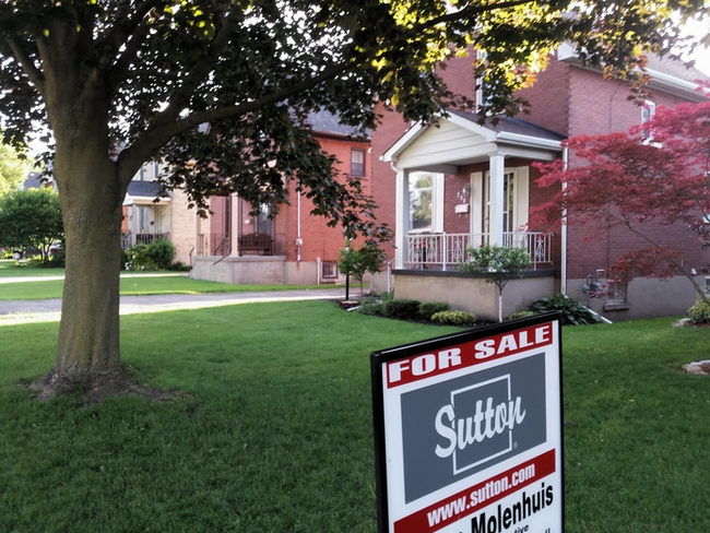 A real estate sign is seen here on Monday, July 17, 2017 in Stratford, Ont. The Huron Perth Association of Realtors says a record-setting amount of houses were sold last month. Terry Bridge/Stratford Beacon Herald/Postmedia Network
