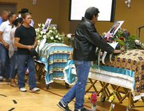 Extended family and friends of Glynnis Fox and Tiffany Ear who were found slain last week in Calgary pack the Bearspaw First Nation Youth Centre for ther memorial in Morley on Monday July 17, 2017. DARREN MAKOWICHUK/Postmedia Network