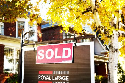 A real estate sold sign hangs in front of a west-end Toronto property, Friday, Nov. 4, 2016. (THE CANADIAN PRESS)