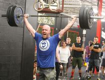 John van Loenen reacts as he lifts weights during the Brock Fit 5 Crossfit competition on Saturday. (Ronald Zajac/The Recorder and Times)