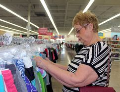 Brigitte Brunk from Stratford peruses clothing for sale at Value Village on Tuesday, July 18, 2017 in Stratford, Ont. The store has been open since June 1. (Terry Bridge/Stratford Beacon Herald/Postmedia Network)