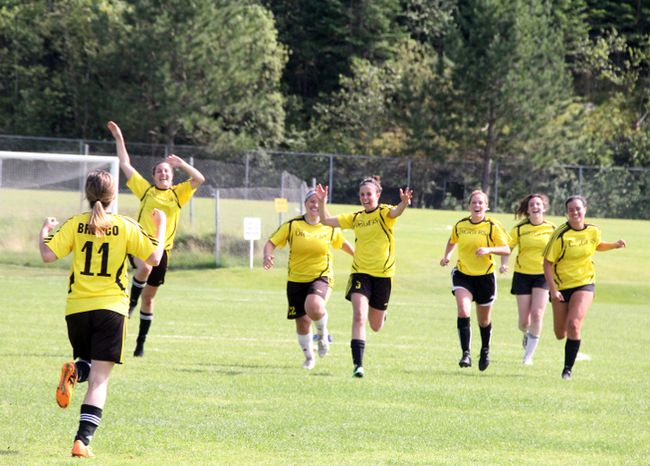 Sam Smith (#11) runs to celebrate with her Brewco Gold-Diggers teammates after securing victory with a goal in the sudden-death round of the shootout against the Winnipeg Titans in the gold-medal game of the Kenora Women's Soccer Invitational tournament, July 16 at Tom Nabb Soccer Park. SHERI LAMB/Daily Miner and News/Postmedia Network