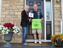 Julie Moretto - CiB committee member- presenting her nomination to her neighbour Gary Skinner in Eagle Ridge in Fort McMurray, Alta. on Monday, July 17, 2017. Ruth Brook/Fort McMurray Today/Postmedia Network