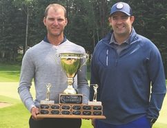 PHOTO SUPPLIED Jake Laubsch, left, is presented with the McLean and Shaw Men's Open title from Pierce Krol, of McLean & Shaw Insurance Brokers. Laubsch captured The Dunes Golf and Winter Club's Men's Open on Sunday.
