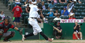 Winnipeg Goldeyes 3B Wes Darvill hits a single in the sixth inning of American Association action against the Lincoln Saltdogs at Shaw Park in Winnipeg on Sun., June 4, 2017. Kevin King/Winnipeg Sun/Postmedia Network