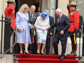 Her Majesty The Queen, attended by the Duke of Edinburgh, visit Canada House on Trafalgar Square to celebrate Canada's 150th anniversary of Confederation.  Her Majesty and The Duke unveil a new Jubilee Walkway Panel outside Canada House.  Featuring: Queen Elizabeth II, Prince Philip, Duke of Edinburgh, Governor General of Canada David Johnston Where: London, United Kingdom When: 19 Jul 2017 Credit: David Sims/WENN.com