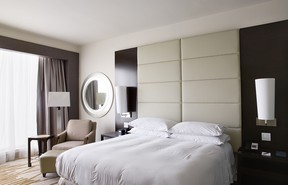 A standard Hilton hotel room in Panama. In the book, paired photos of interiors and window views are displayed on facing pages. (Roger Eberhard)
