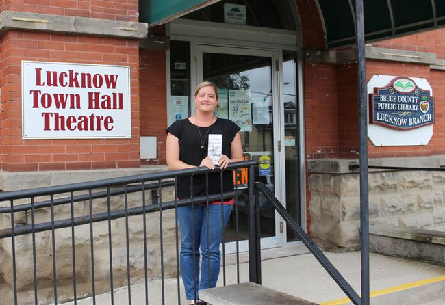 Historical Walking Tours of Lucknow and Ripley are available to the public and now an audio recording of the tours is coming soon. The Township of Huron-Kinloss has decided to take the tours to the next level by producing an audio recording of the tour for people to walk, listen and learn at the same time. The Historical Walking Tours have been set up to specifically feature the town of Lucknow, Ripley and Huron-Kinloss all in celebrating these wonderful communities. Pictured: Staff member Michelle Goetz of the Township of Huron-Kinloss stands at one of Lucknow's historical sites and shows off the Historical Walking Tour brochure. (Ryan Berry/ Kincardine News and Lucknow Sentinel)