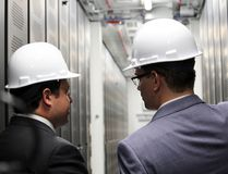 Mayor Christian Provenzano and Convergent Energy CEO Johannes Rittershausen tour the new 7 MW energy storage project in Sault Ste. Marie. The Independent Electricity System Operator will monitor over the next three years how the technology stores energy until its needed on the grid.