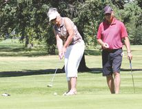 Hole in one. Wendy, left, tries her luck at the hole in one, with husband Jack Williams standing beside her. Couple is from Arrowwood.