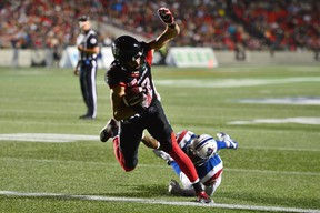 Ottawa Redblacks wide receiver Brad Sinopoli scores a touchdown past Montreal Alouettes defensive back Tyree Hollins during CFL action in Ottawa on July 19, 2017. (THE CANADIAN PRESS/Sean Kilpatrick)