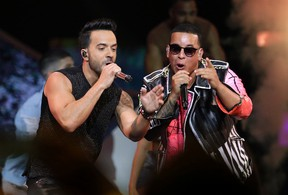 In this April 27, 2017 file photo, singers Luis Fonsi, left and Daddy Yankee perform during the Latin Billboard Awards in Coral Gables, Fla. (AP Photo/Lynne Sladky, File)