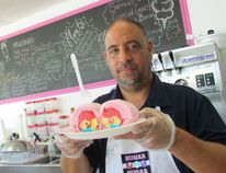 Martin Lacombe came up with the idea for cotton candy ice cream burritos at the Sugar, Sugar ice cream shop he opened in March with his wife Malynda on London Road in Sarnia, Ont. He's shown here Wednesday July 19 2017. The dessert's popularly has grown in recent weeks, fueled by online videos attracting millions of viewers. (Paul Morden/Sarnia Observer)