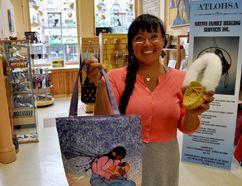 Lorna Chrysler, social enterprise manager with Atlohsa Native Family Healing Services, holds a couple items at Atlohsa Gifts. The new social enterprise opened June 21 and benefits numerous programs and services at Atlohsa. (CHRIS MONTANINI, Londoner)