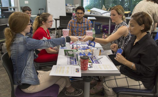 Shane Ganness (centre) acts as a facilitator as (from left) Milijana Dancetovic, Kelly Hayhurst, Brittany Hunt and Azra Chaudhry play the board game SUSPECT on Friday June 23, 2017 in Brantford, Ontario. Ganness is one of two Laurier Brantford Game Design and Development students who designed the board game for the Workforce Planning Board of Grand Erie, with the aim to help people improve problem solving and communication skills. (Brian Thompson/Brantford Expositor/Postmedia Network)