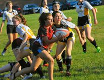 Norfolk Harvesters scrum-half Abbey Anderson (with ball) is one of seven locals selected to various Ontario Blues teams this summer. JACOB ROBINSON/Simcoe Reformer