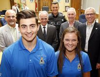 Belleville Police summer students Brock Abbott and Makenna Clayton get the backing of the Belleville Police Services Board Thursday, July 20, 2017 at city hall in Belleville, Ont. Both have held several volunteer positions with other organizations. Behind them from left were mayor and board chairman Taso Christopher, vice-chairman Brad Devolin, Chief Ron Gignac, provincial appointee Tom Lafferty and member and city councillor Jack Miller. Luke Hendry/Belleville Intelligencer/Postmedia Network