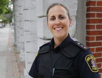 Belleville Police Insp. Sheri Meeks stands on Front Street Thursday, July 20, 2017 in Belleville, Ont. She recently scored 100 per cent on her Ontario Police Fitness Award test, a voluntary but difficult physical exam. The Belleville Police Service has Ontario's highest per-capita ratio of officers who've passed the test, Chief Ron Gignac said. Luke Hendry/Belleville Intelligencer/Postmedia Network