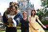 In this handout photo provided by Disney Parks, actress, singer, artist and Disney Legend Paige O'Hara strikes a royal pose with Belle and Beast while vacationing at Magic Kingdom Park, Walt Disney World Resort June 1, 2017 in Lake Buena Vista, Florida. (Chloe Rice/Disney Parks via Getty Images)