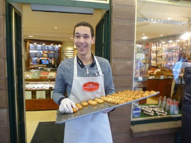 An staffer at Maison Alsacienne offers macaroons -- not to be confused with that other French treat, macarons -- to passersby in Colmar, France.(ROBIN ROBINSON/TORONTO SUN)