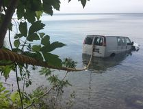 Van sits in Lake Erie on July 21, 2017 after it was driven off a cliff at the end of Baldwin Road south of County Road 50 in Essex. (Jason Kryk/Windsor Star)