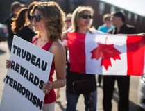 Protesters stand outside of Paramount Fine Foods before Prime Minister Justin Trudeau spoke at an event in Mississauga, Ont., Thursday, July 20, 2017. THE CANADIAN PRESS/Mark Blinch