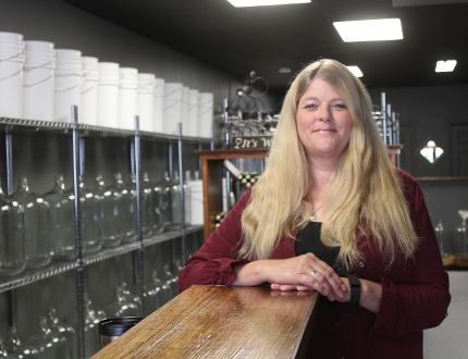Linda Rouse is the owner of the new micro-winery The Rustic Wine Cellar on Churchill Crescent in St. Thomas. The store opened just last week and has been struggling with business because of the construction out front. (Laura Broadley/Times-Journal)