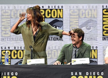 Actor Halle Berry (L) takes a drink onstage while actor Pedro Pascal looks on at the 20th Century FOX panel during Comic-Con International 2017 at San Diego Convention Center on July 20, 2017 in San Diego, California.  (Photo by Kevin Winter/Getty Images)