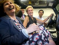 <p>Ontario Premier Kathleen Wynne (centre, beside Ottawa-Vanier MPP Nathalie Des Rosiers) toured Blackberry QNX Autonomous Vehicle Innovation Centre in Kanata Friday (July 21, 2017). Before fielding questions about Hydro One purchasing a company with interests in a coal plant, the Premier took a ride in QNX's driverless car - a Lincoln MKZ, capable of totally autonomous driving. </p><p> Julie Oliver/Postmedia Network