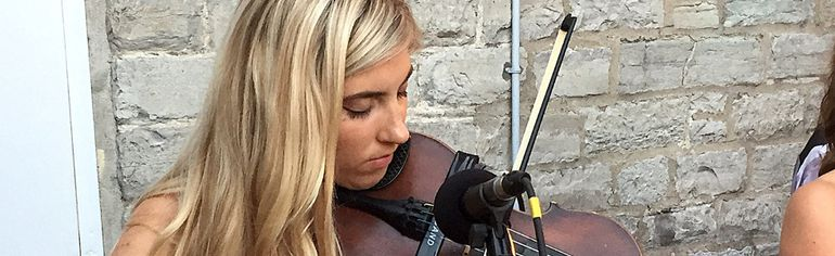 Claire Bouvier performs with an old violin at Pan Chancho Restaurant on Thursday with her Relative bandmates. Bouvier's electric violin and other musical equipment were stolen from her car the day before. (Ian MacAlpine/The Whig-Standard)