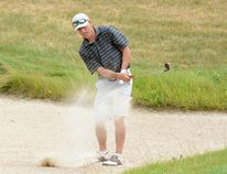 Dan Roy is able to successfully play a shot out of the bunker during the opening round of the 2017 Molson Lever-Sullivan Classic at the Hollinger Golf Club on Saturday. Roy and his partner Paul Quesnel were among 108 two-man teams who played 18 holes of best-ball golf during Round 1. Action will continue on Sunday, with the teams organized into flights based upon Saturday's results. THOMAS PERRY/THE DAILY PRESS