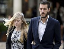 Charlie Gard's parents, Connie Yates and Chris Gard, arrive at the Royal Courts of Justice in London where the hearing will resume into the case of their terminally-ill baby, Friday July 21, 2017. (Lauren Hurley/PA via AP)