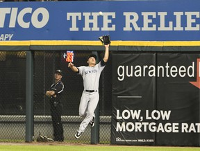 Rob Refsnyder #38 of the New York Yankees makes a catch on Alen Hanson #39 of the Chicago White Sox during the fourth inning on June 29, 2017 at Guaranteed Rate Field in Chicago, Illinois. (David Banks/Getty Images)