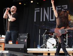 Finger Eleven's lead vocalist Scott Anderson (left) and guitarist Rick Jackett (right) perform during the East Coast Garden Party at South Bear Creek Park on Friday July 21, 2017 in Grande Prairie, Alta. Finger Eleven is Canadian rock band from Ontario. Many came out to see the different bands perform. Nicole Auger/Grande Prairie Daily Herald-Tribune/Postmedia Network