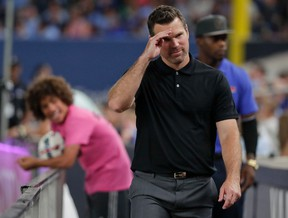 Toronto FC head coach Greg Vanney makes a saluting gesture to fans as he walks off the field after receiving a red card and was sent off in the second half of an MLS soccer game against the New York City FC, Wednesday, July 19, 2017, in New York. The game ended in a 2-2 tie. (AP Photo/Julie Jacobson)