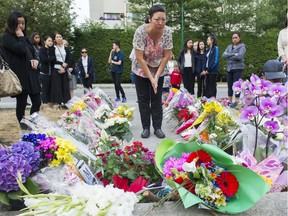 A woman pays her respects at a memorial for Marrisa Shen at Central Park Burnaby, July 22 2017. Gerry Kahrmann / PNG staff photo)