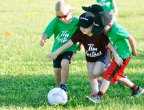 McKenna Schoonderwoerd (middle) appears to be using her arms to slow down opponents Carter Murray (left) and Jase Van Nynatten from reaching the soccer ball during recent Blastball action at Keterson Park. The Wednesday night ritual – where youngsters split their time playing baseball and soccer – has been taking place since late May and concludes tonight (July 26), with the kids showing great improvement over the course of the season. ANDY BADER/MITCHELL ADVOCATE