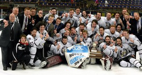 The MacEwan University Griffins men's hockey team poses with the 2016-17 ACAC championship banner following a 4-3 overtim win over the NAIT Ooks in Edmonton on Sunday, March 19, 2017. MacEwan also won the ACAC title in women's hockey this season. It was the men's first championship since 2004.