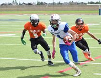 Salisbury Sabre-bound Kolby Hurford leaves defenders behind him en route to the end zone for Team Alberta in a 28-0 victory over Team British Columbia. Photo Courtesy Blair Takahashi
