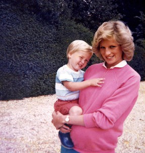 """In this photo made available by Kensington Palace from the personal photo album of the late Diana, Princess of Wales, shows the princess holding Prince William whilst pregnant with Prince Harry, and features in the new ITV documentary 'Diana, Our Mother: Her Life and Legacy.' Prince William and Prince Harry will pay tribute to their mother, Princess Diana, as the 20th anniversary of her death in a car crash approaches in a TV documentary """"Diana, Our Mother: Her Life and Legacy"""" which will air Monday July 24, 2017 on British TV. (The Duke of Cambridge and Prince Harry/Kensington Palace via AP)"""